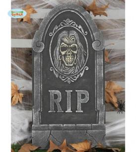 Lápida decorativa con calavera